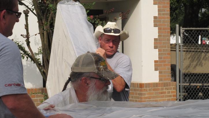 Volunteers deliver mattresses after Tropical Storm Imelda