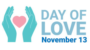 """Teal hands encompass a pink heart. Next to them, text reads """"Day of Love, November 13"""""""