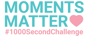 """Teal text that reads """"MOMENTS MATTER"""" with a pink heart. Underneath, the hashtag #1000SecondChallenge in pink."""