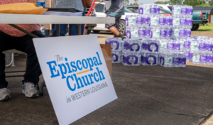 The Episcopal Church in Western Louisiana hands out bottled water and gift cards to the local grocery store to local residents still affected by last year's Hurricane Laura and Hurricane Delta at Evergreen Missionary Baptist Church in DeQuincy, Louisiana on July 17, 2021.