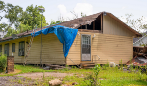Residences in DeQuincy, Louisiana are still severely damaged and under construction almost a year after back-to-back Hurricanes Laura and Delta swept through the area in August and October.