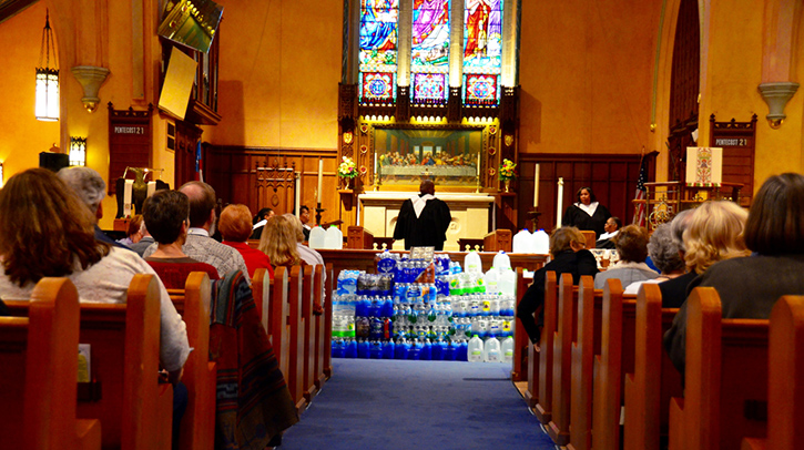Flint church with water at altar.
