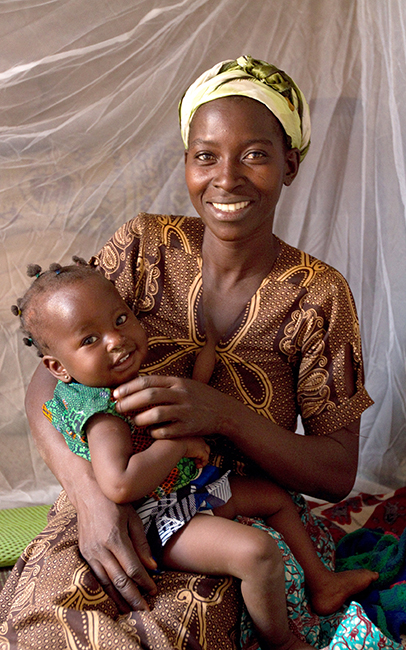 Ghanian woman with smiling child.