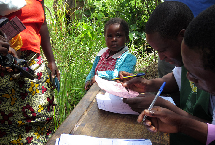 A child registering for the Zambia ECD program.