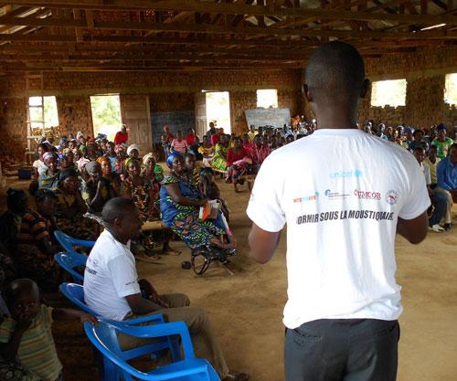 Malaria Control Agents speak to crowd at church in Maniema