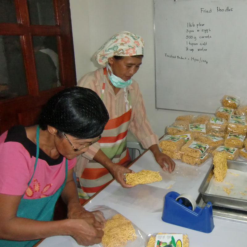 Making vegetable noodles for relief packs in the Philippines