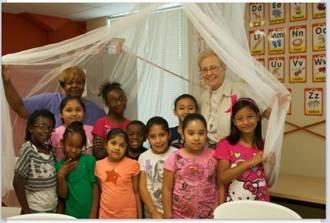 The Rev. Joy Daley with children